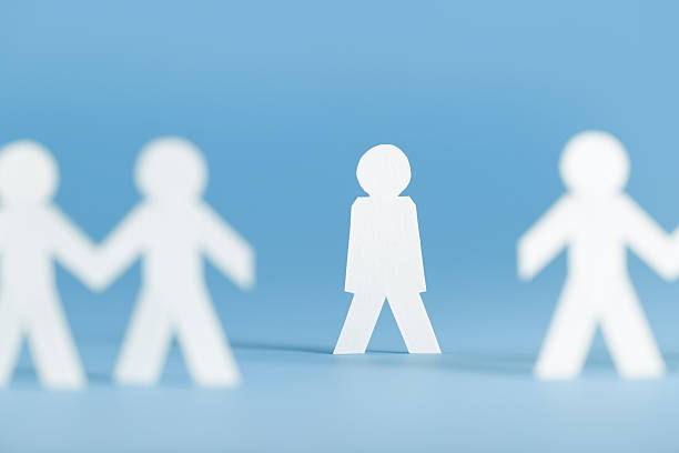 paper figures holding hands with one alone not participating - disbarment stock pictures, royalty-free photos & images