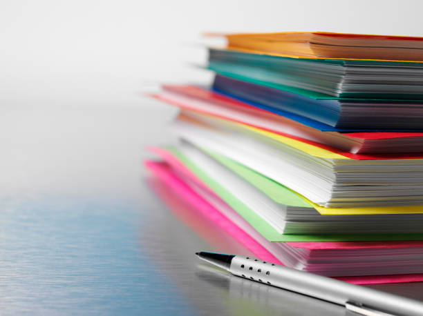 Paper Files on a Desk Coloured paper business files on a stainless steel background with copy space.  Differential focus.  ring binder stock pictures, royalty-free photos & images