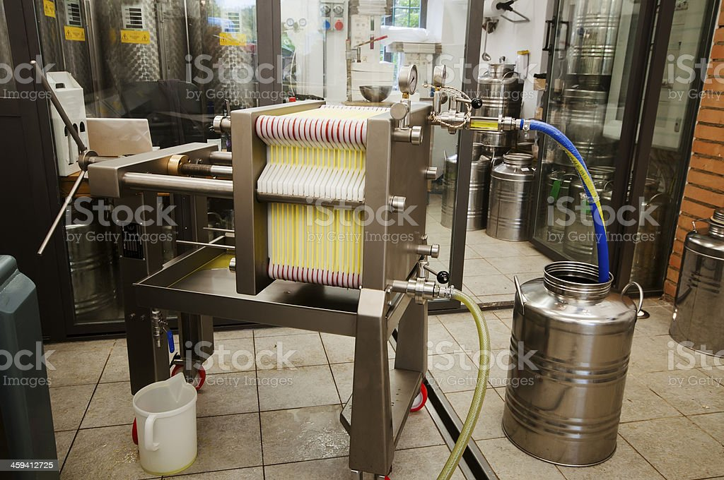 Paper filter for extracting extra virgin olive oil stock photo