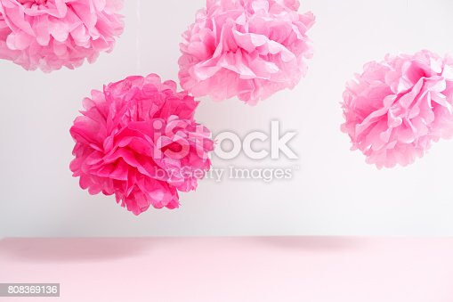 istock Paper flowers at the girl baby shower party.  Baby shower celebration concept 808369136