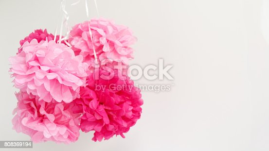 istock Paper flowers at the girl baby shower party.  Baby shower celebration concept 808369194