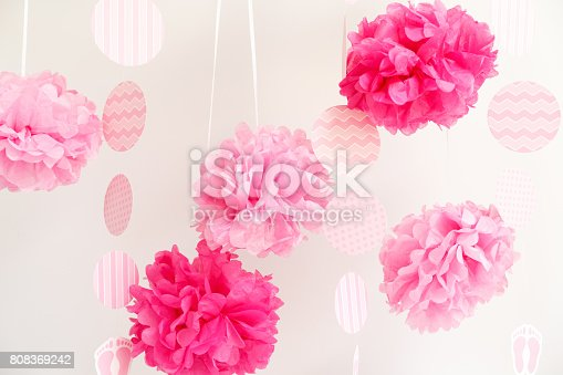 istock Paper flowers at the girl baby shower party.  Baby shower celebration concept 808369242