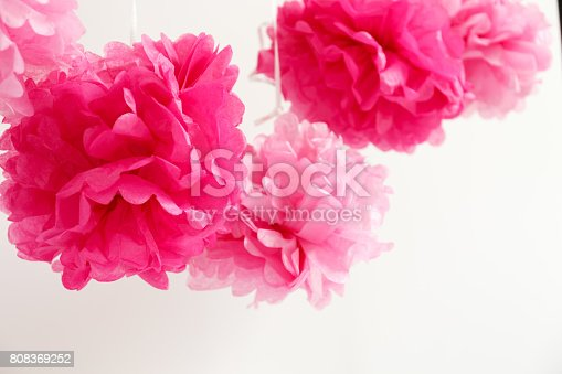 591421282 istock photo Paper flowers at the girl baby shower party.  Baby shower celebration concept 808369252