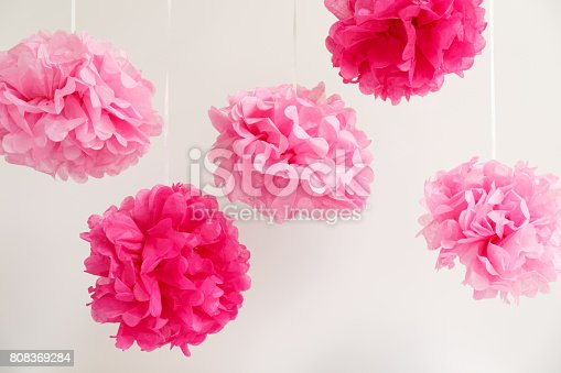 591421282 istock photo Paper flowers at the girl baby shower party.  Baby shower celebration concept 808369284