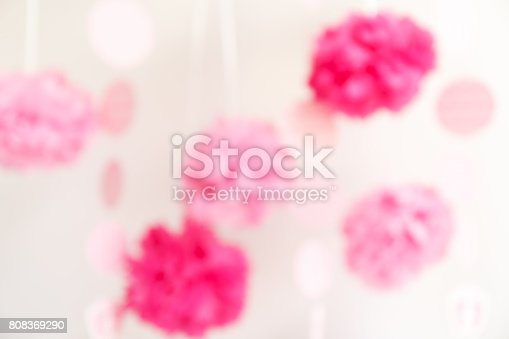 591421282 istock photo Paper flowers at the girl baby shower party.  Baby shower celebration concept 808369290