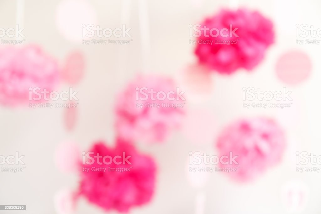 Paper flowers at the girl baby shower party.  Baby shower celebration concept stock photo