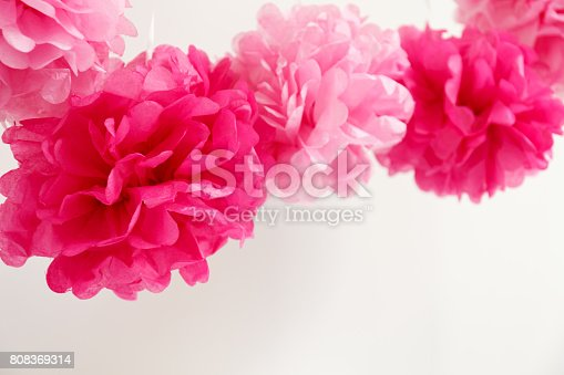 istock Paper flowers at the girl baby shower party.  Baby shower celebration concept 808369314