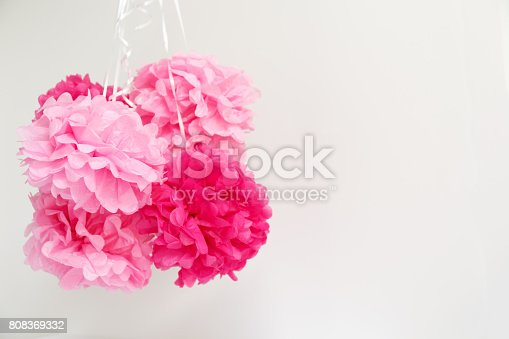 591421282 istock photo Paper flowers at the girl baby shower party.  Baby shower celebration concept 808369332