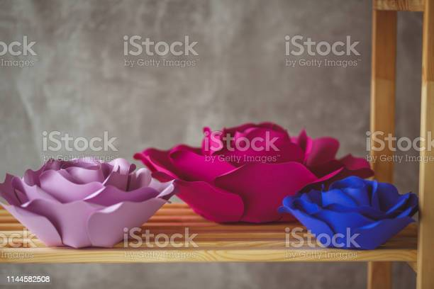Paper flowers on the shelf picture id1144582508?b=1&k=6&m=1144582508&s=612x612&h=0kcw1vixvnwnzzyu8xicxvumlw876idygwga8m9 lhy=