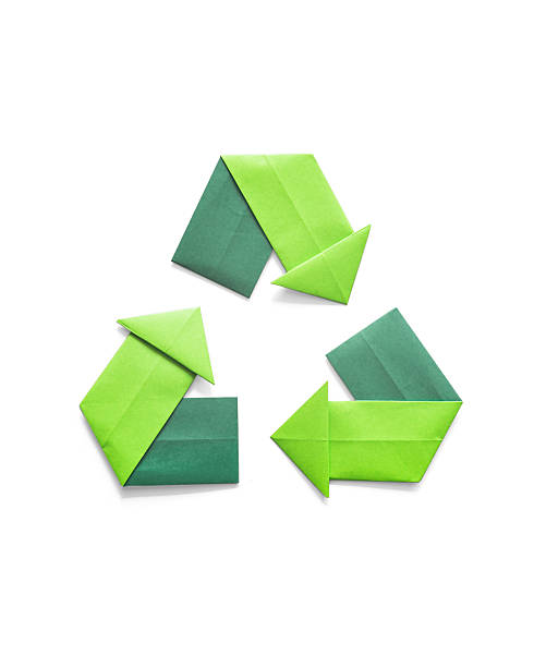 paper folded origami recycling symbol environmental concept - recycling symbol stock photos and pictures