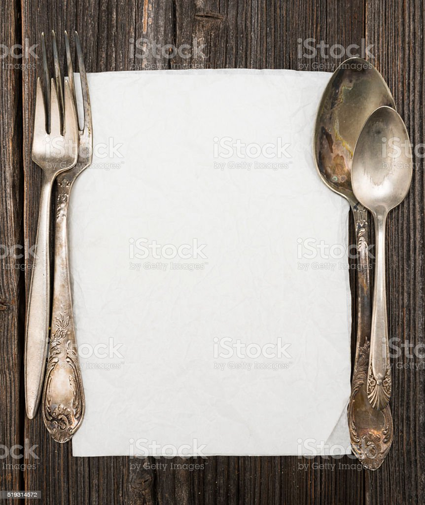 Paper for menu and fork and spoon stock photo
