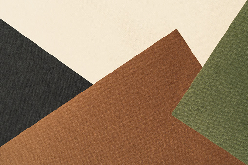 Paper for pastel overlap in black, beige, green and terracotta colors for background, banner, presentation template. Creative modern trendy background design in natural colors. Trendy paper for pastel background in vintage style.