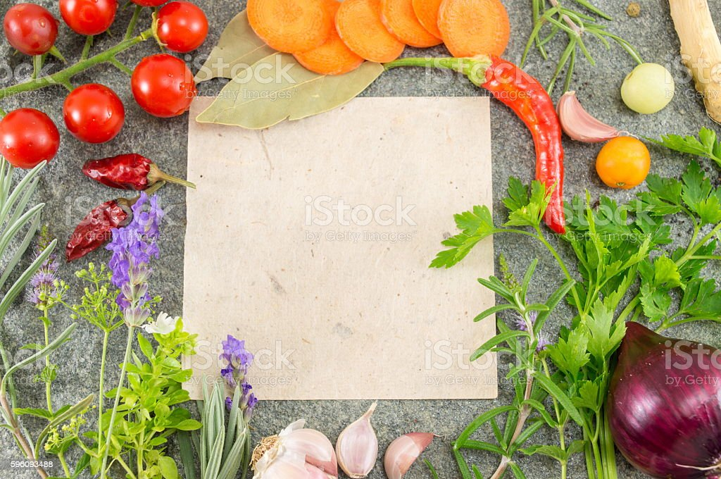 Paper for writing recipe surrounded by vegetables royalty-free stock photo