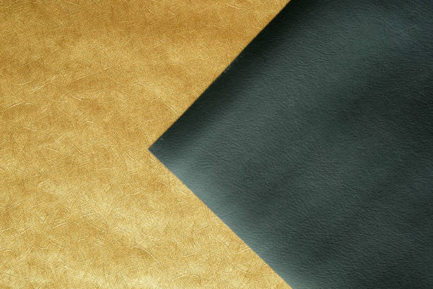 Paper gold sheet and Black leather abstract background texture ,Luxury and elegant stock photo
