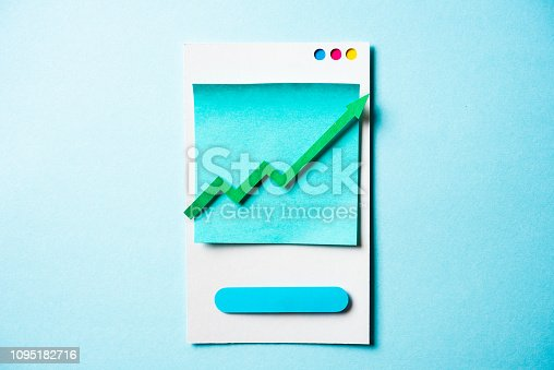 904389218istockphoto Paper green arrow growing up on smartphone and blue background. Growth business graph chart, stock market investment trading and trends concept. 1095182716