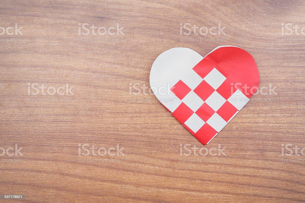 paper heart on wooden floor stock photo