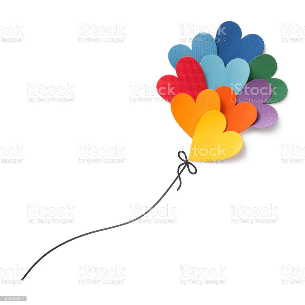 Paper hearts balloon flying stock photo