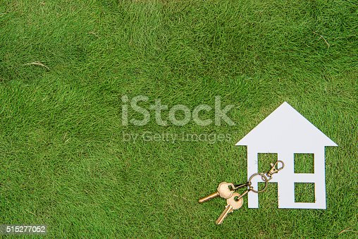 istock Paper house and key, home environment green living 515277052