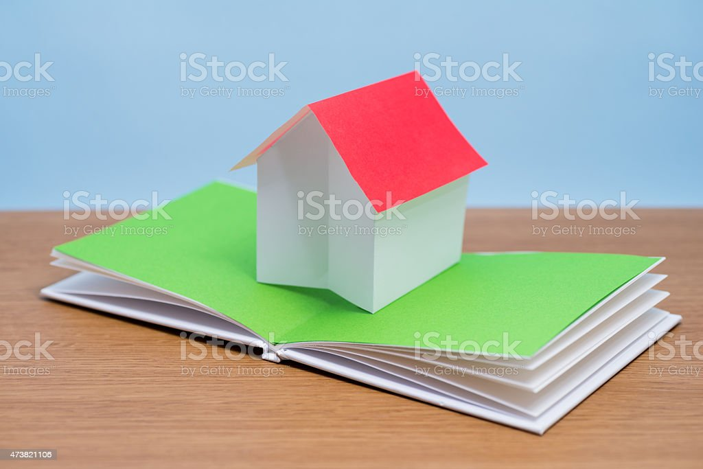 Paper house in pop-up book (XXXlarge) stock photo