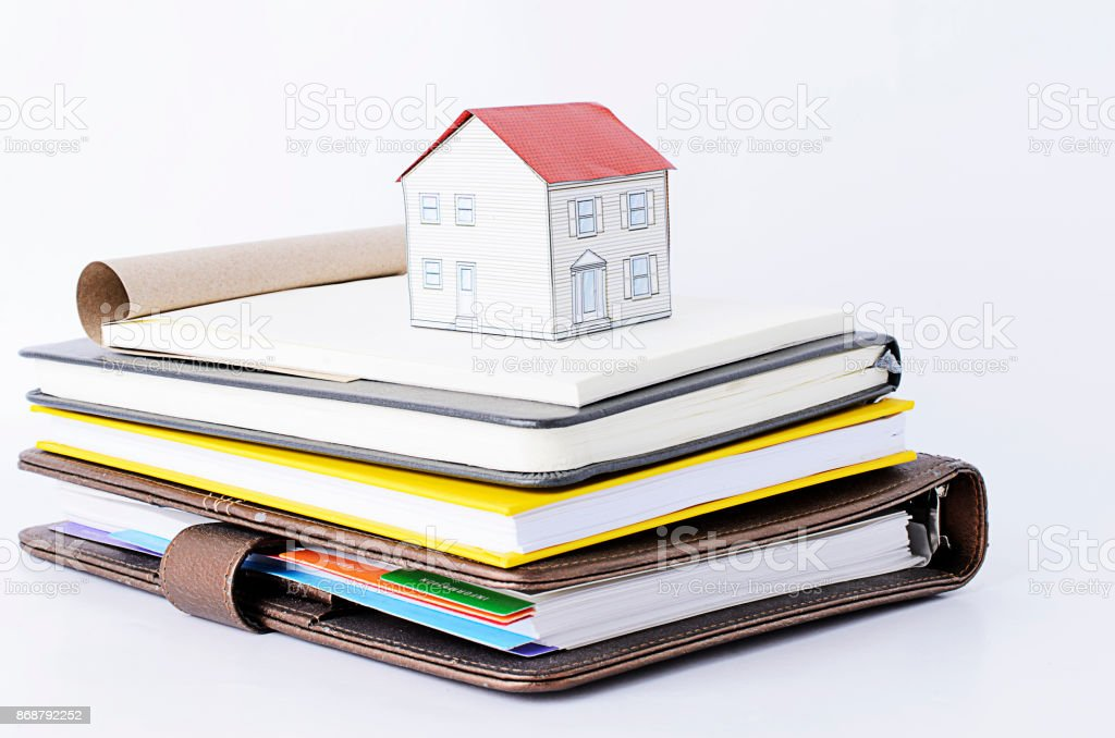 Paper house on Books stack stock photo