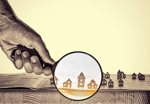 626187670 istock photo Paper house under a magnifying lens 626187690