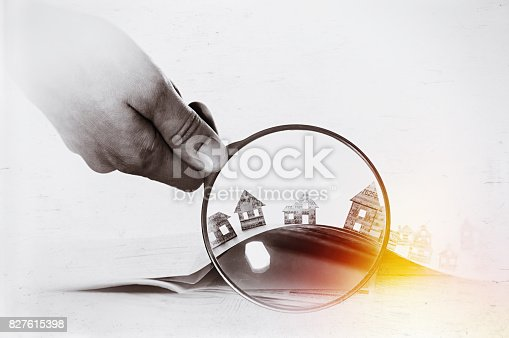 istock Paper house under a magnifying lens 827615398