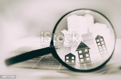 istock Paper house under a magnifying lens 908722932