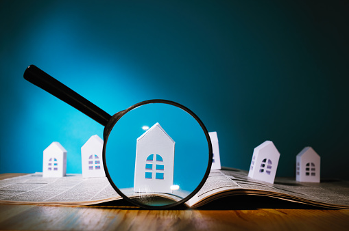 istock Paper house under a magnifying lens 911728592