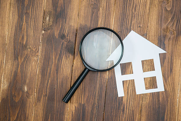paper house with Magnifying Glass, House hunting stock photo