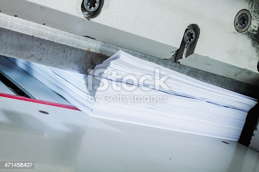 Paper ready to be cutted in an automatic paper trimmer