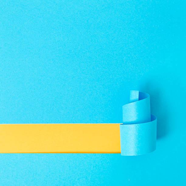 paper in the shape of a christmas tree - blue yellow band bildbanksfoton och bilder