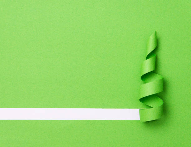 paper in the shape of a christmas tree - christmas green stock photos and pictures