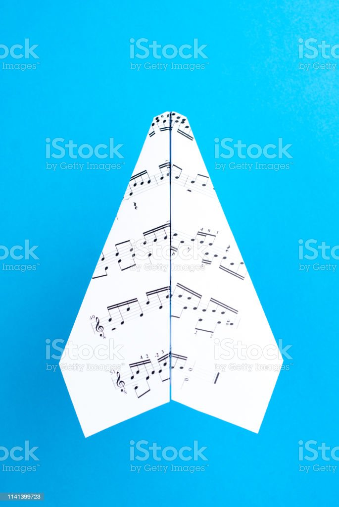 Paper jet /paper airplane made of a music score. Music score paper...