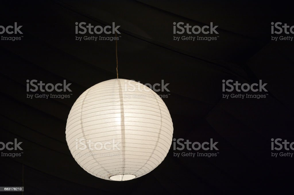 Paper lantern lamp hang from a ceiling stock photo