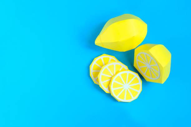 Paper lemon (whole fruit, half and slices) stock photo