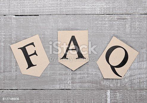 istock FAQ paper letter symbol motivation on wooden board 612748926