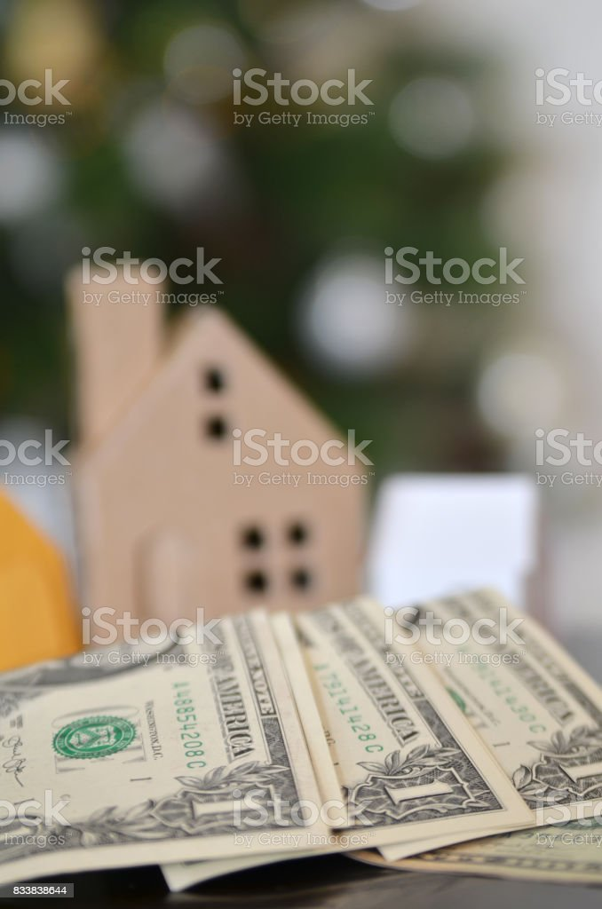 Paper made house stands on dollar money stock photo