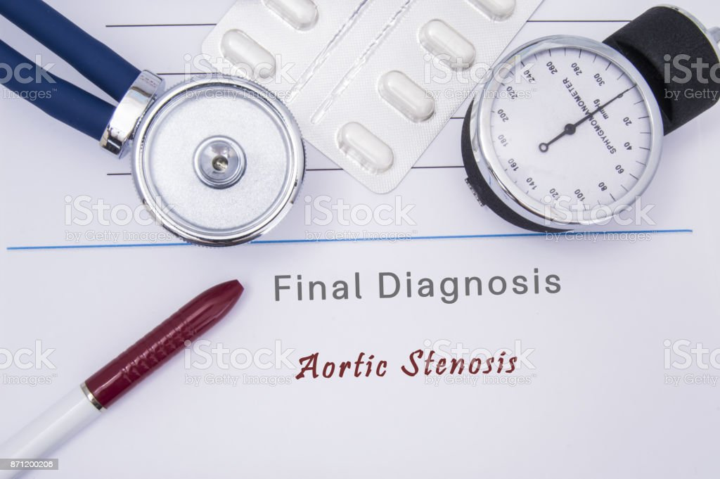 Paper medical form with the diagnosis of Aortic Stenosis on which lie the stethoscope, blood pressure monitor, white tablets or pills in a blister pack and a red ballpoint pen stock photo