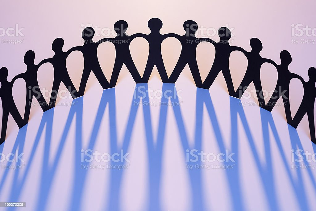 Paper Men Joined Together As Team, Union, Network, Family stock photo