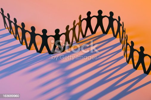istock Paper Men Joining Together As Team, Union, Family or Network 163689960