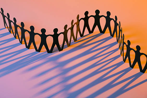 Paper Men Joining Together As Team, Union, Family or Network stock photo