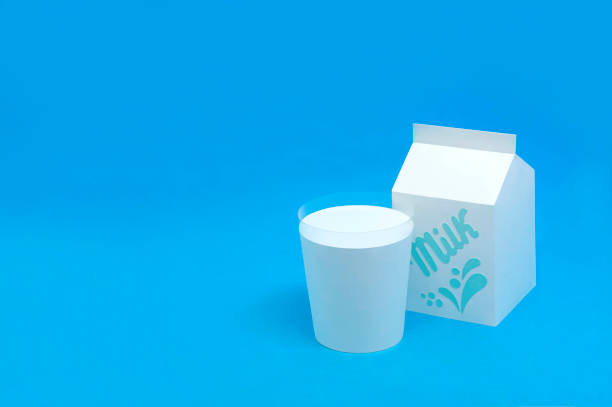 Paper milk in box and glass stock photo