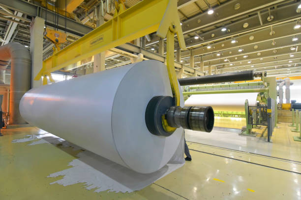 paper mill: production of paper rolls for the printing industry - paper rolls in a factory stock photo