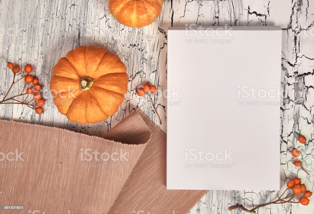 Paper mockup for your artwork or text with Autumn decorations