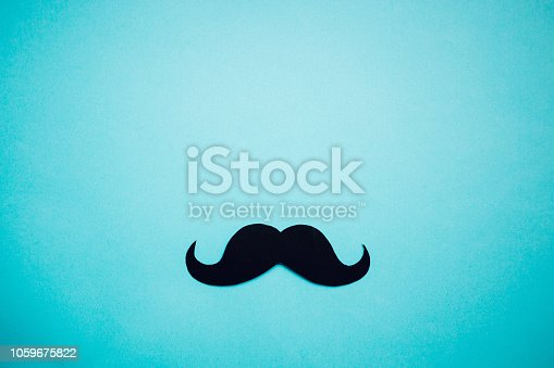 istock Paper Mustache on blue background, Prostate cancer awareness , Men health awareness month, cope space 1059675822