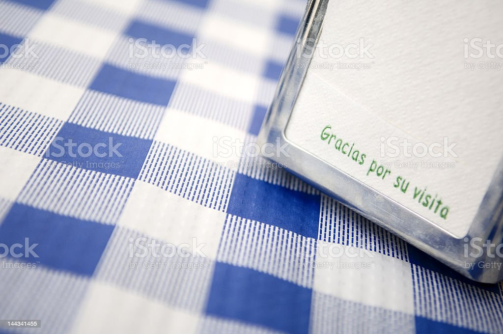 Paper napkins on gingham tablecloth stock photo