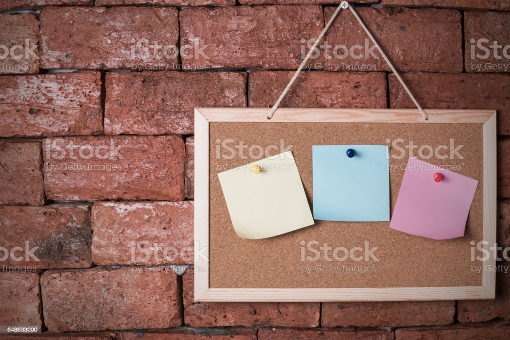 Paper Note On Wood Board And Old Brick Background Stock Photo Download Image Now
