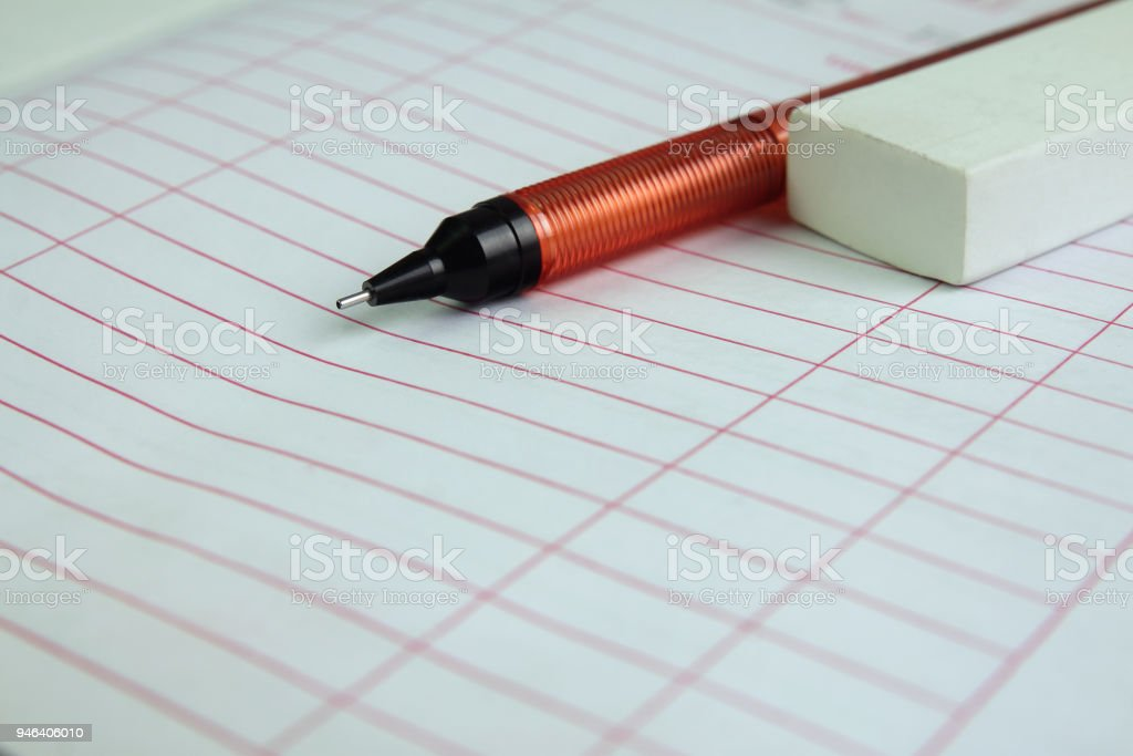 Paper notebook with pencil and eraser