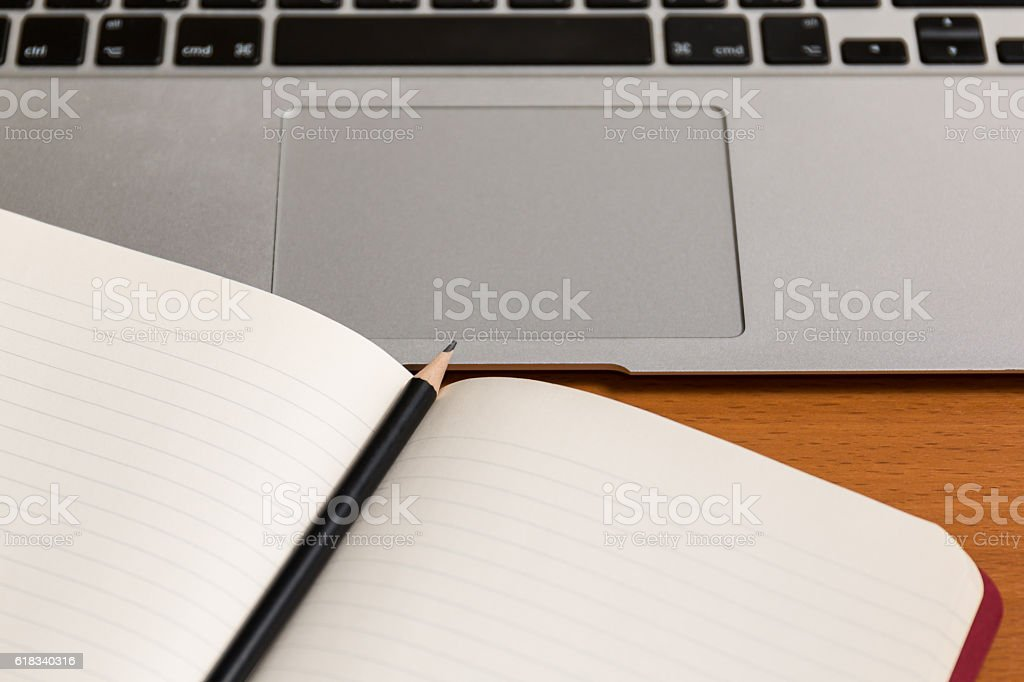 Paper notebook with pencil in the middle stock photo