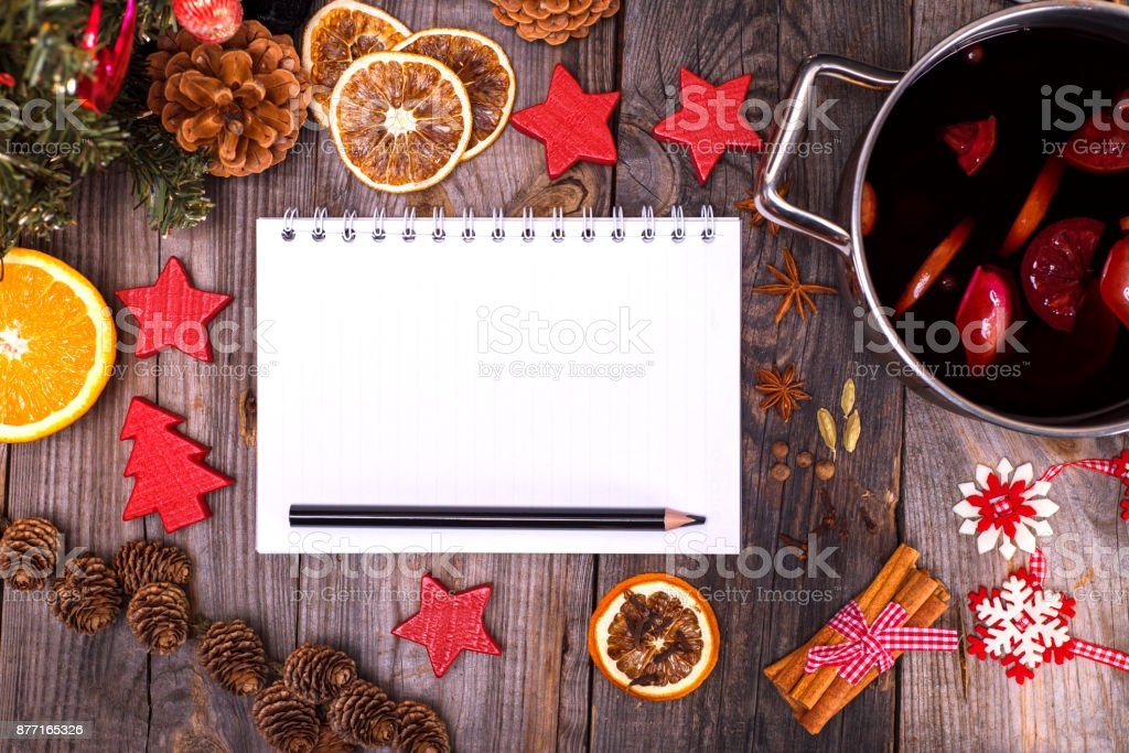 empty paper notebook with white pages and a black pencil, next to...